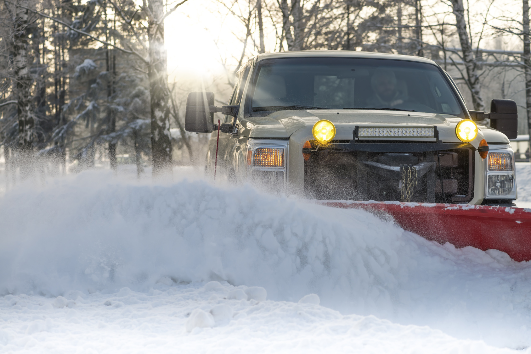 Snow plow doing snow removal after a blizzard
